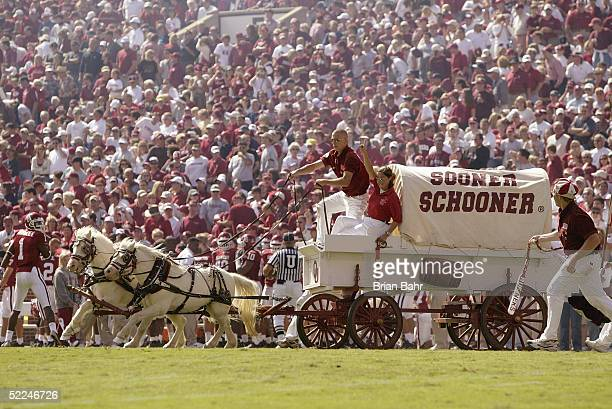 The Oklahoma Sooner Schooner travels across the field before the football game against Texas Tech Red Raiders on October 2 2004 at Memorial Stadium...