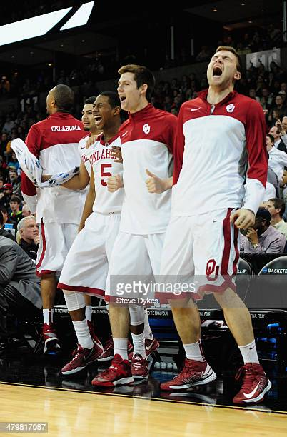 The Oklahoma Sooners bench react after a shot by teammate Cameron Clark to put them ahead by three points in the last minute of the game against the...