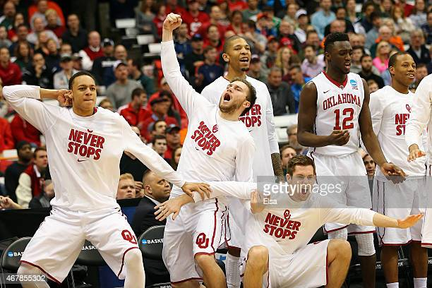 The Oklahoma Sooners bench reacts to a shot in the second half of the game against the Michigan State Spartans during the East Regional Semifinal of...