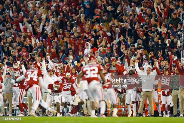 The Oklahoma Sooners celebrate after the defense stopped the TCU Horned Frogs on fourth down in the fourth quarter on November 23, 2019 at Gaylord...