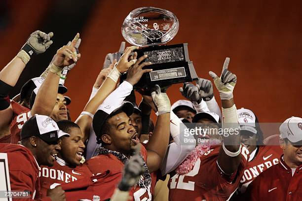 The Oklahoma Sooners celebrate after winning the 2006 Dr Pepper Big 12 Championship against the Nebraska Cornhuskers on December 2 2006 at Arrowhead...