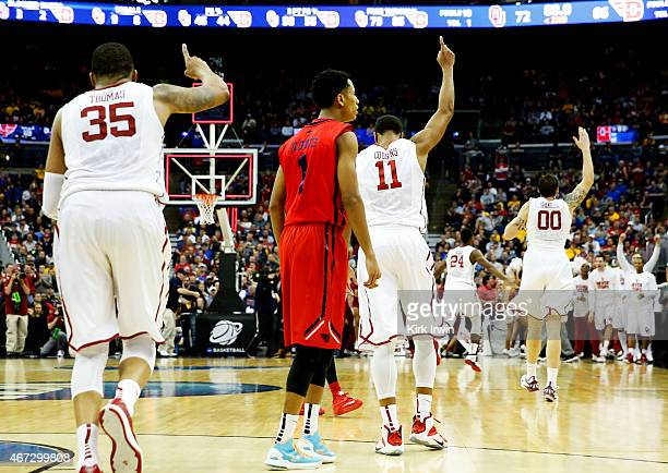 The Oklahoma Sooners celebrate their 72 to 66 win over the Dayton Flyers during the third round of the 2015 NCAA Men's Basketball Tournament at...