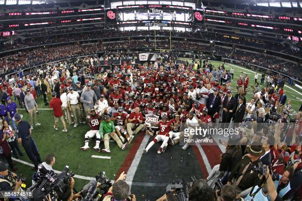The Oklahoma Sooners celebrate with a team photo after defeating the TCU Horned Frogs 4117 in the Big 12 Championship ATT Stadium on December 2 2017...