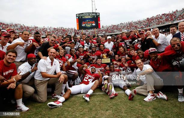 The Oklahoma Sooners celebrate with the ATT Red River Rivalry trophy after the Oklahoma Sooners beat the Texas Longhorns 6321 at Cotton Bowl on...