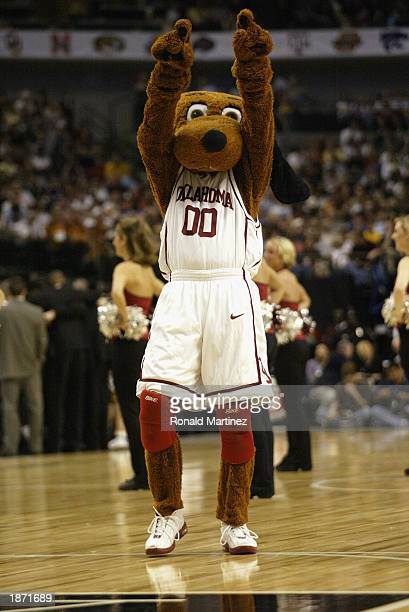 The Oklahoma Sooners mascot Top Dawg cheers against the Missouri Tigers during the Finals of the Phillips 66 Big 12 Championship Tournament at the...