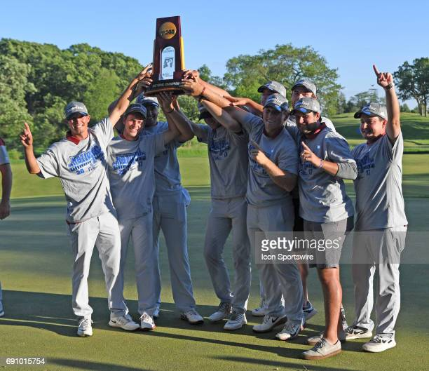The Oklahoma Sooners pose for a photo with the trophy after defeating the Oregon Ducks in final round of the NCAA Division I Men's Golf Championship...