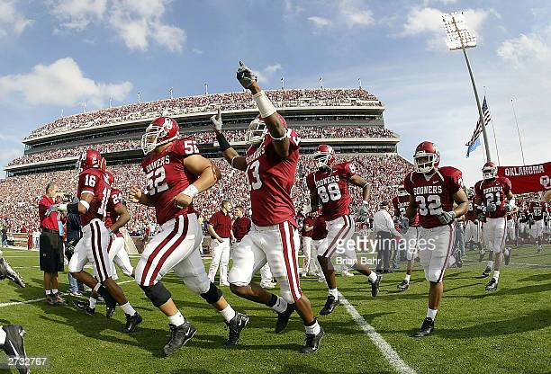 The Oklahoma Sooners run onto the field for a game against the Baylor Bears November 15 2003 at Memorial Stadium in Norman Oklahoma The Sooners won...