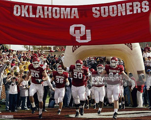The Oklahoma Sooners run out before the game against the Baylor Bears on November 15 2003 at Memorial Stadium in Norman Oklahoma The Sooners won 413...