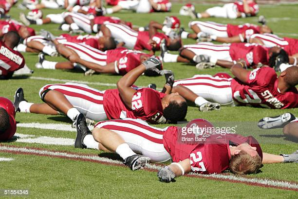 The Oklahoma Sooners stretch before their game against the Kansas Jayhawks on October 23 2004 at Memorial Stadium in Norman Oklahoma It didn't appear...