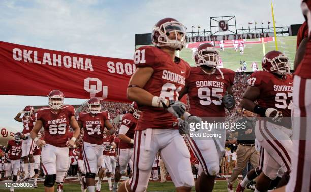 The Oklahoma Sooners take the field before the game against the Missouri Tigers on September 24 2011 at Gaylord FamilyOklahoma Memorial Stadium in...