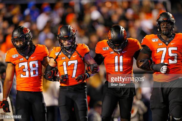 The Oklahoma State Cowboys captains linebacker Philip RedwineBryant wide receiver Dillon Stoner linebacker Amen Ogbongbemiga and offensive lineman...