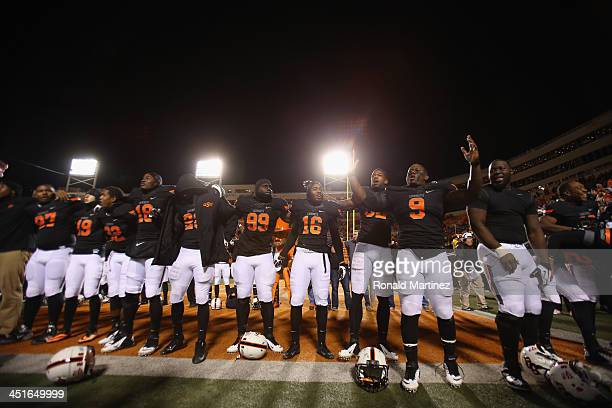 The Oklahoma State Cowboys celebrate a 4917 win against the Baylor Bears at Boone Pickens Stadium on November 23 2013 in Stillwater Oklahoma