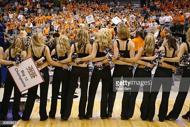 The Oklahoma State Cowboys cheerleaders and band play the school song after the team defeated the Texas Longhorns during the finals of the Phillips...