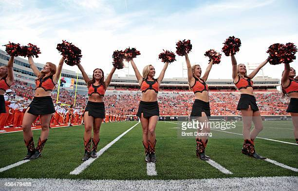 The Oklahoma State Cowboys cheerleaders perform before the game against the Texas Tech Red Raiders September 25 2014 at Boone Pickens Stadium in...