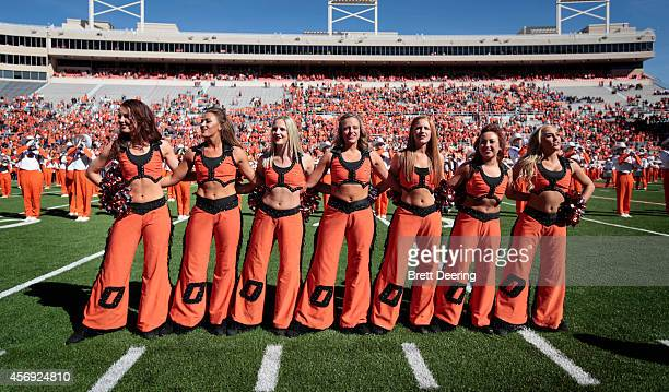 The Oklahoma State Cowboys cheerleaders perform before the game against the Iowa State Cyclones October 4 2014 at Boone Pickens Stadium in Stillwater...