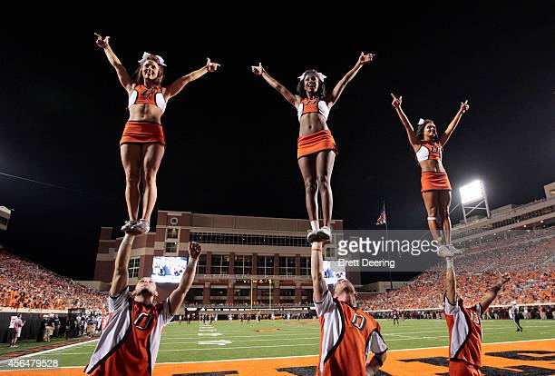 The Oklahoma State Cowboys cheerleaders perform during the game against the Texas Tech Red Raiders September 25 2014 at Boone Pickens Stadium in...