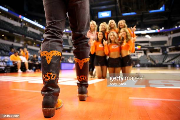 The Oklahoma State Cowboys cheerleaders pose prior to the game between the Oklahoma State Cowboys and the Michigan Wolverines during the first round...