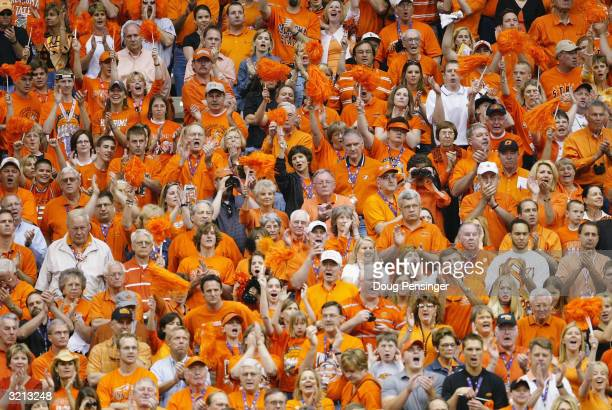 The Oklahoma State Cowboys fans cheer their team on against the Georgia Tech Yellow Jackets during the semifinal game of the NCAA Final Four...