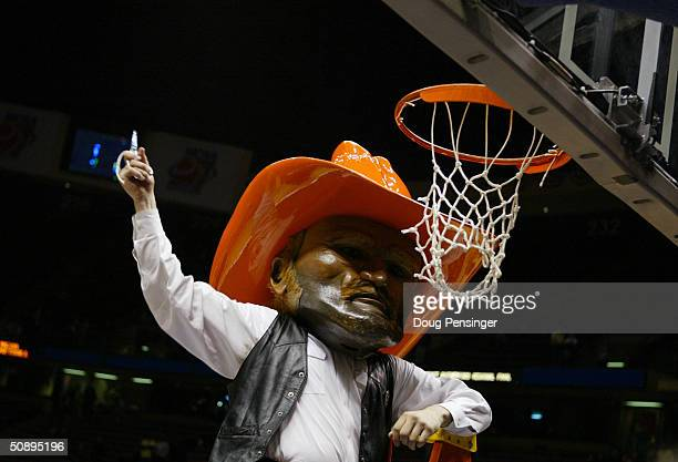 The Oklahoma State Cowboys mascot cuts down the net after the Elite 8 game of the NCAA Division I Men's Basketball Tournament against the St Joseph's...