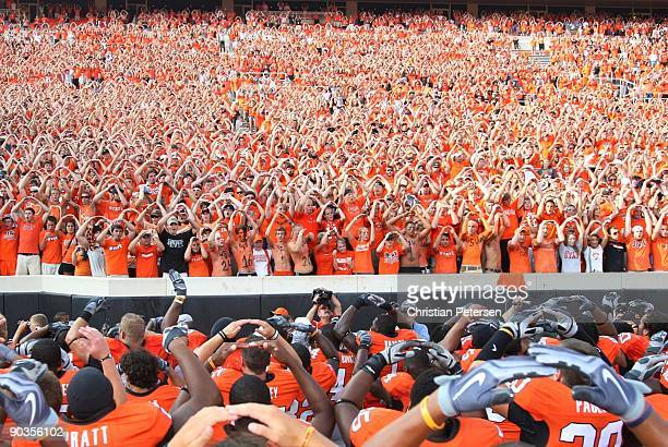 The Oklahoma State Cowboys sing their school's Alma Mater with fans after their 24-10 victory over the Georgia Bulldogs at Boone Pickens Stadium on...