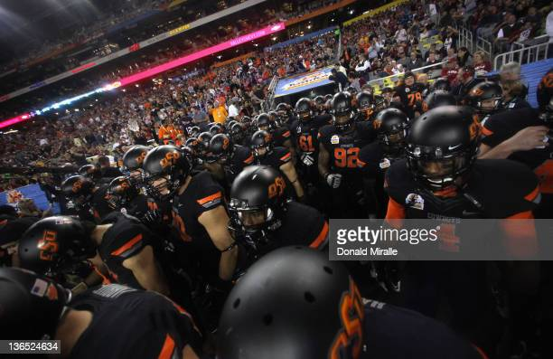 The Oklahoma State Cowboys take the field against the Stanford Cardinal during the Tostitos Fiesta Bowl on January 2, 2012 at University of Phoenix...
