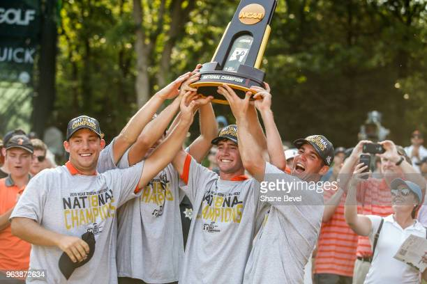 The Oklahoma State men's golf team hoists the trophy after winning the Division I Men's Golf Team Match Play Championship held at the Karsten Creek...