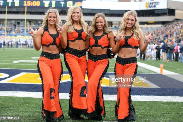 The Oklahoma State Pom Squad on the field during the second quarter of the college football game between the Oklahoma State Cowboys and the West...