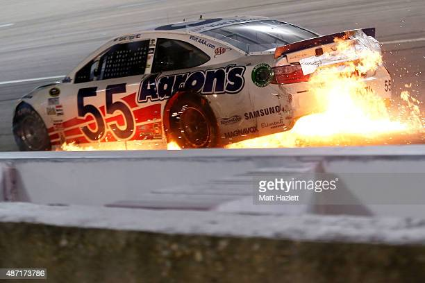 The Ol' Aaron's Dream Machine Toyota driven by David Ragan catches fire after being involved in an ontrack incident during the NASCAR Sprint Cup...