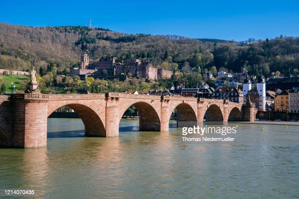 The old Bridge in Heidelberg is seen without many people on March 22 in Heidelberg, Germany. Everyday life in Germany has become fundamentally...