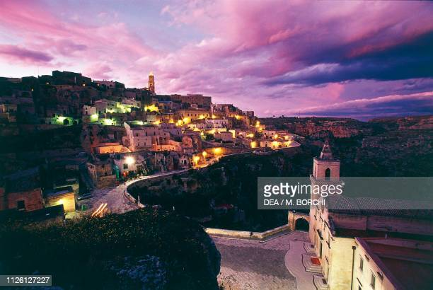 The old city with the neighborhood Sasso Caveoso and the Church of San Pietro Caveoso 13th17th century at sunset Matera Basilicata Italy