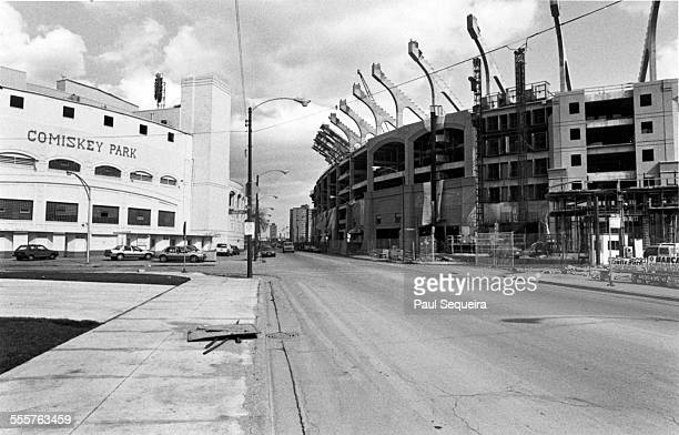 The old Comiskey Park left home of the Chicago White Sox baseball team sits across from the construction site of the team's new stadium Chicago...