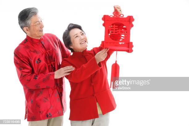 the old couple celebrate the spring festival - マオカラー ストックフォトと画像