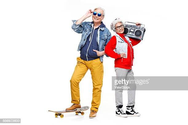 The old couple with a skateboard and recorder