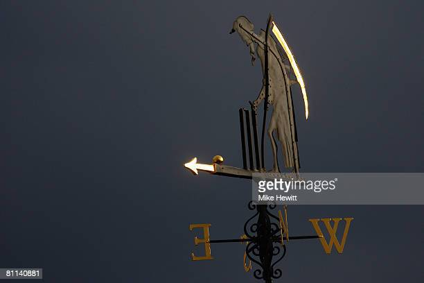The Old Father Time weather vane is seen in the late evening sunlight during the fourth day of the 1st npower Test Match between England and New...