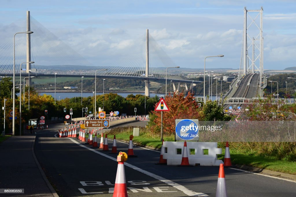 The old Forth Road Bridge (R) alongside the new Queensferry Crossing (L), as Transport Scotland announces it will re-open to some scheduled bus services on Friday, October 13, 2017, on October 12, 2017 in South Queensferry, Scotland. The bridge has been closed for roadworks since the opening of the Queensferry Crossing, to prepare it for a new role as a' public transport corridor' which will eventually carry most buses, taxis, and motorcycles, as well as cyclists and pedestrians.