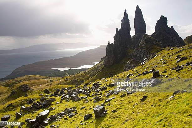 The Old Man of Storr towering above Loch Leathan and Sound of Raasay, Trotternish Peninsula, near Portree.