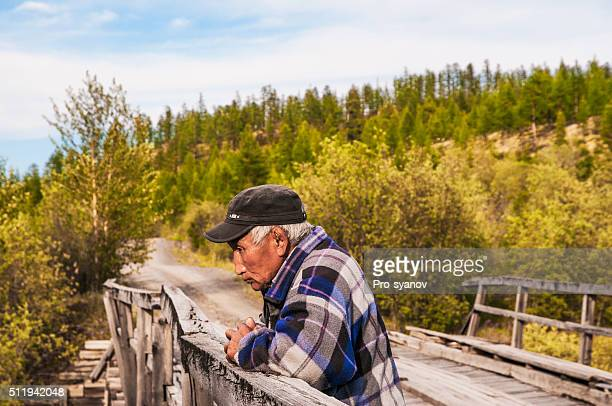 The old man on the old wooden bridge.