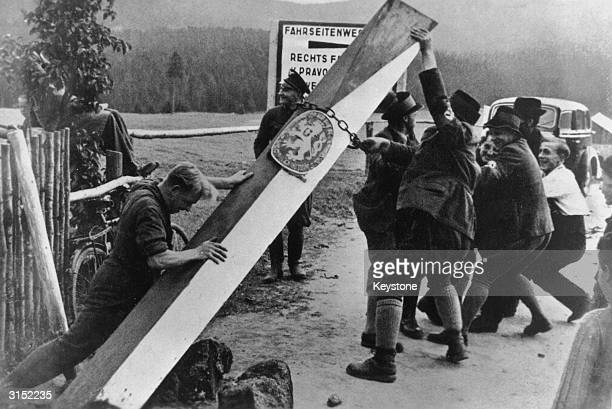 The old markers of the Czech/German border are pulled down after the Munich agreement allowed the annexation of the Sudeten or Germanpopulated...