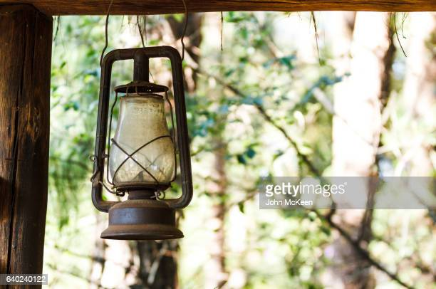 the old oil lantern - oil lamp stock pictures, royalty-free photos & images