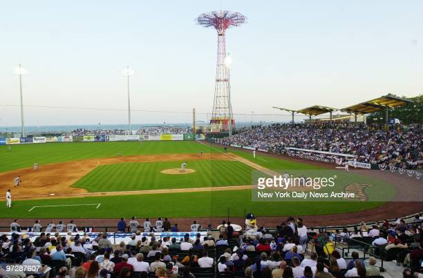 The old parachute jump towers in the background as the Brooklyn Cyclones make their home debut before a crowd of 7,500 in their new KeySpan Park in...