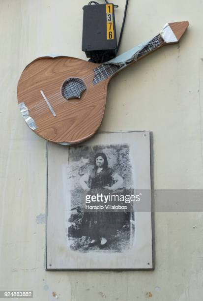 The old picture of a Fado singer part of 'Retratos de Fado' exhibit hangs under the recreation of a Portuguese guitar in Mouraria neighborhood on...