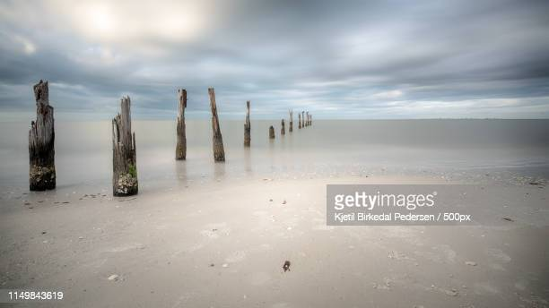 the old pier at fort myers beach - fort myers beach stock-fotos und bilder