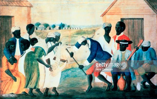 'The Old Plantation' 1800 Plantation slaves dancing in front of their wooden cabins accompanied by banjo and drum From the collection of the...