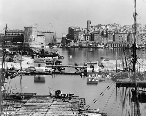 The Old Port Of Marseille used exclusively by fishermen and to the left a building an old fort now used as a prison located at the end of the...