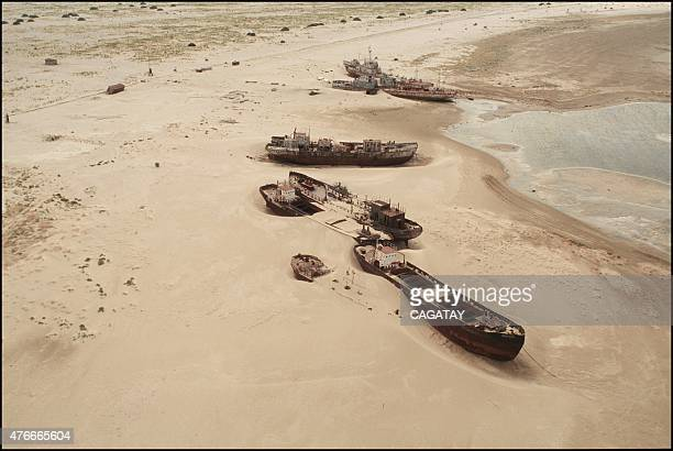 The old port of the Vozrojdentya island in the Aral Sea and the dramatic scene of the ships slowly being covered with blowing sand beacause of the...