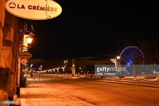 The Old Port, which usually attracts tourists, is pictured deserted moments after the curfew was implemented from 8pm local time till 5am in...