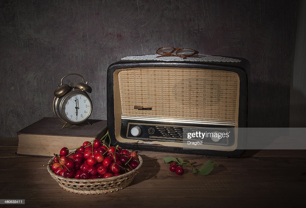 The old radio and fresh cherries : Stock Photo