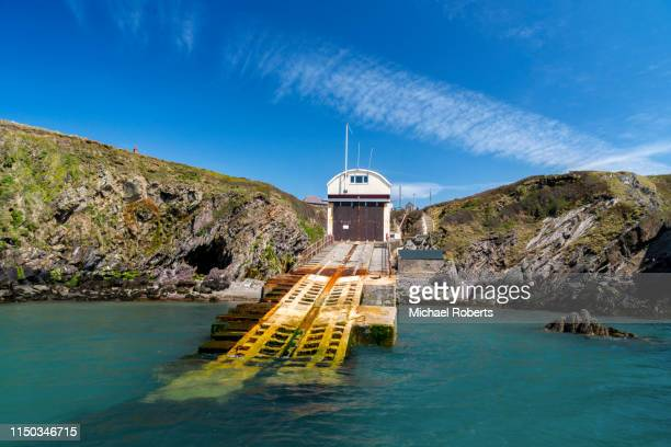 the old st davids lifeboat station at st justinian on the pembrokeshire coast path. - st davids day stock pictures, royalty-free photos & images