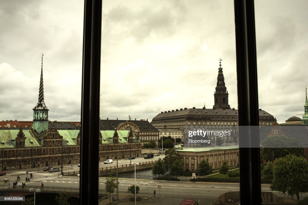 The old stock exchange building, left, also known as Borsbygningen, and Christiansborg Palace, right, sit on the city skyline seen from the headquarters of the Danish central bank in Copenhagen, Denmark, on Wednesday, Sept. 13, 2017. 'We have previously seen that the economy can overheat vigorously and suddenly when it is booming, Denmark's Central Bank Governor Lars Rohdesaid in a statement on Wednesday.Photographer: Carsten Snejbjerg/Bloomberg via Getty Images