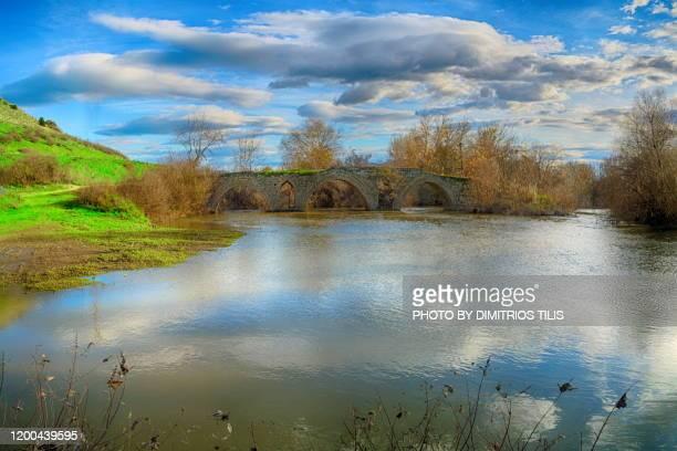 the old stone bridge at keramidi - dimitrios tilis stock pictures, royalty-free photos & images